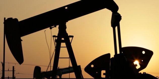 FILE -- In this Sept. 30, 2015, file photo, oil pumps work in the desert oil fields of Sakhir, Bahrain....