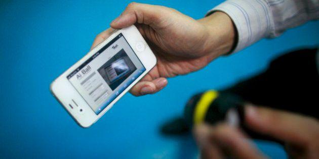 A Trek employee demonstrates the Ai Ball wifi video camera in Singapore December 19, 2012. Singapore's...