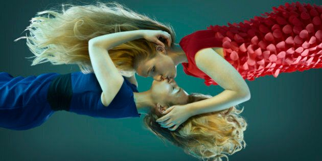 Two women kissing, floating in mid