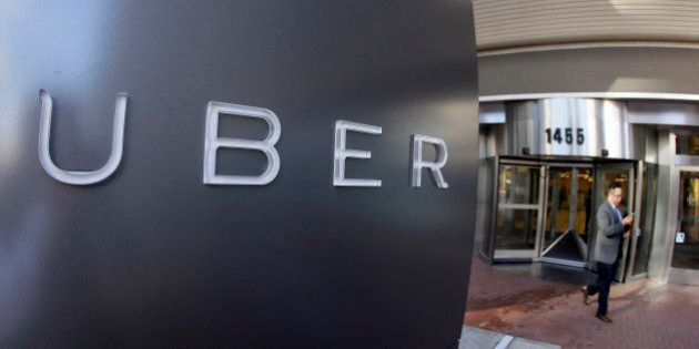 FILE - In this Dec. 16, 2014, file photo a man leaves the headquarters of Uber in San Francisco. The...