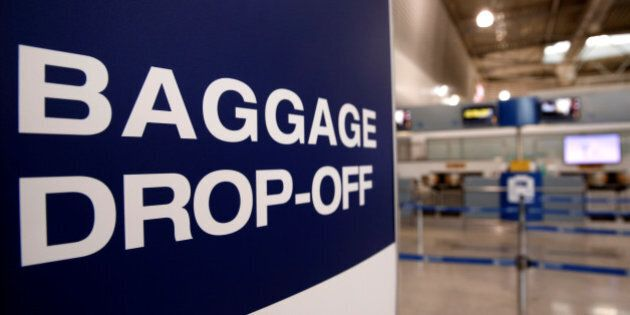 A sign indicates a baggage drop-off area at the Eleftherios Venizelos International Airport in Athens,...