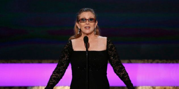 Actress Carrie Fisher introduces her mother, actress Debbie Reynolds, as the recipient of the Life Achievement...