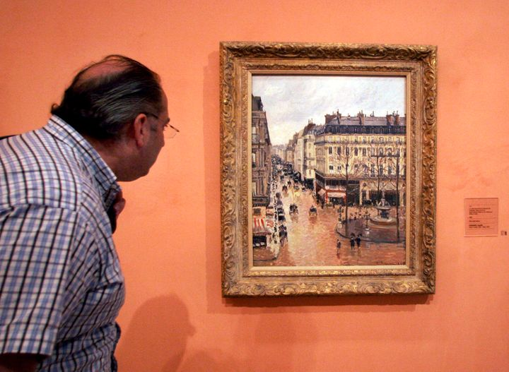 "The impressionist painting ""Rue St.-Honore, Apres-Midi, Effet de Pluie,"" on display in the Thyssen-Bornemisza Museum in Madri"