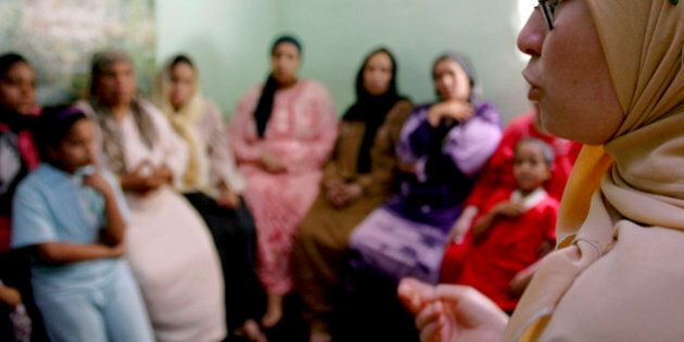 A counsellor talks to a group of women to try to convince them that they should not have FGM (Female...