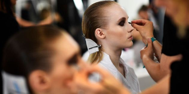 Models have their make-up applied inside Blenheim Palace ahead of a fashion show presenting the Dior, Cruise 2017 Collection, in Woodstock, Britain May 31, 2016.     REUTERS/Dylan Martinez