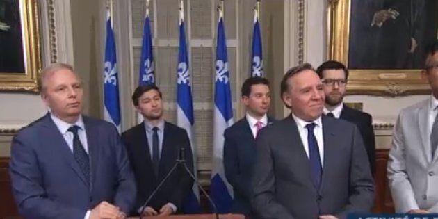 Jean-François Lisée, Gabriel Nadeau-Dubois et François Legault lors d'une conférence de presse, mercredi