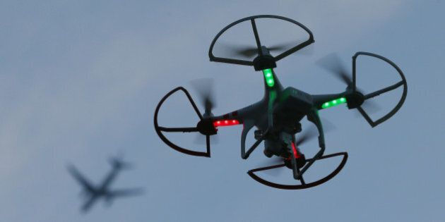 OLD BETHPAGE, NY - AUGUST 30: A drone is flown for recreational purposes as an airplane passes overhead...