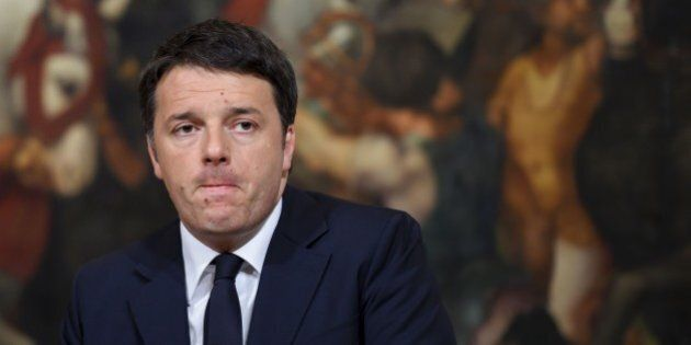 Italy's Prime Minister Matteo Renzi reacts during a press statement following the blasts at Brussels...