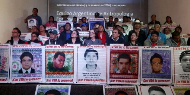 Members of the Argentine Team of Forensic Anthropology (EAAF), relatives of the 43 students missing from...
