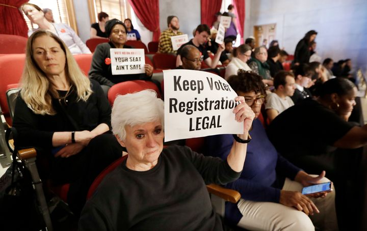 Voting rights activists say a new voter registration law is intended to make it harder to vote in reaction to a surge of vote