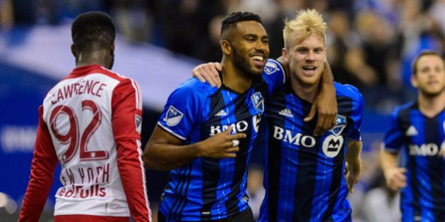 MONTREAL, QC - MARCH 12: Anthony Jackson-Hamel #24 of the Montreal Impact celebrates his goal with teammate...