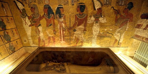 The golden sarcophagus of King Tutankhamun in his burial chamber is seen in the Valley of the Kings,...