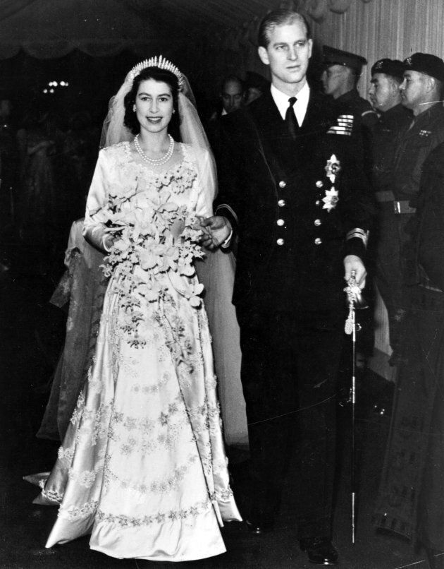 Queen Elizabeth II, as Princess Elizabeth, and her husband the Duke of Edinburgh, styled Prince Philip in 1947, on their wedding day, 1952.