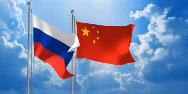 Flags from Russia and China flying side by side for important talks.