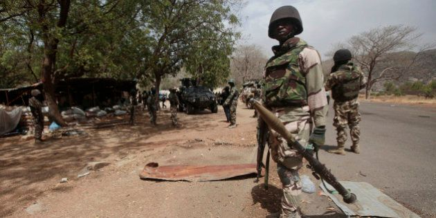 FILE - In this Wednesday April 8, 2015 file photo, Nigerian soldiers man a checkpoint in Gwoza, Nigeria,...