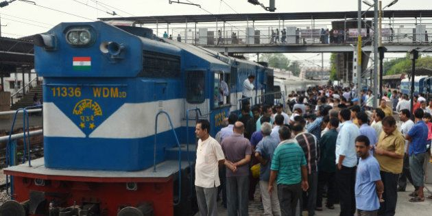 BAREILLY, INDIA - MAY 29: Passengers looking at Spanish train Talgo at Bareily Railway Station during...