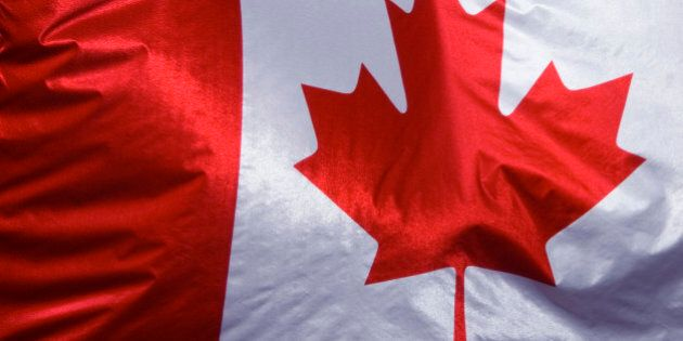 Close up of Canadian flag, hanging from a