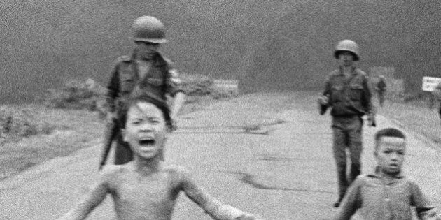 FILE - This is a June 8, 1972 file photo of South Vietnamese forces follow after terrified children,...