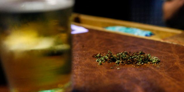 A customer's mix of half marijuana and tobacco sits on a table inside of Frankie Sports Bar and Grill...