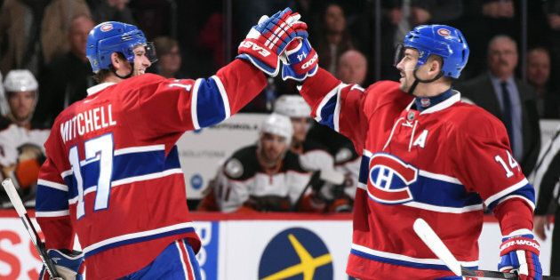 MONTREAL, QC - MARCH 22: Tomas Plekanec #14 of the Montreal Canadiens celebrates after scoring a goal...