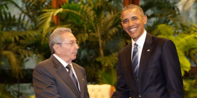 Cuban President Raul Castro, left, shakes hands with U.S. President Barack Obama during a meeting in...