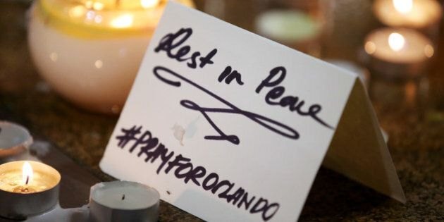 A note is placed at an impromptu candle-lit memorial set up in Sydney, Monday, June 13, 2016, following...