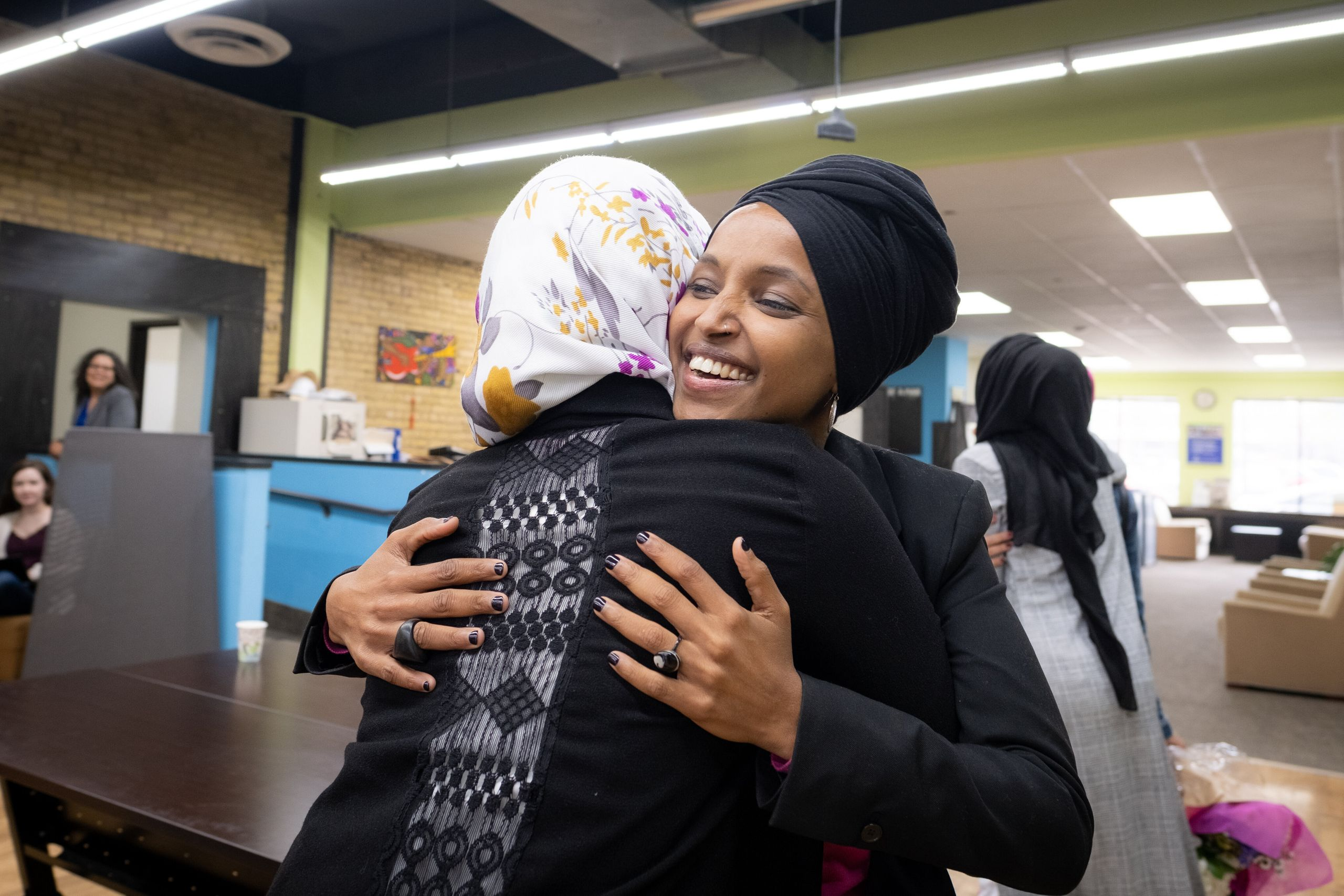 Representative Ilhan Omar greets community members at the RISE (Reviving Sisterhood) office in North Minneapolis on April 24,