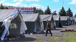 Migrants: l'Ontario exige; le Québec