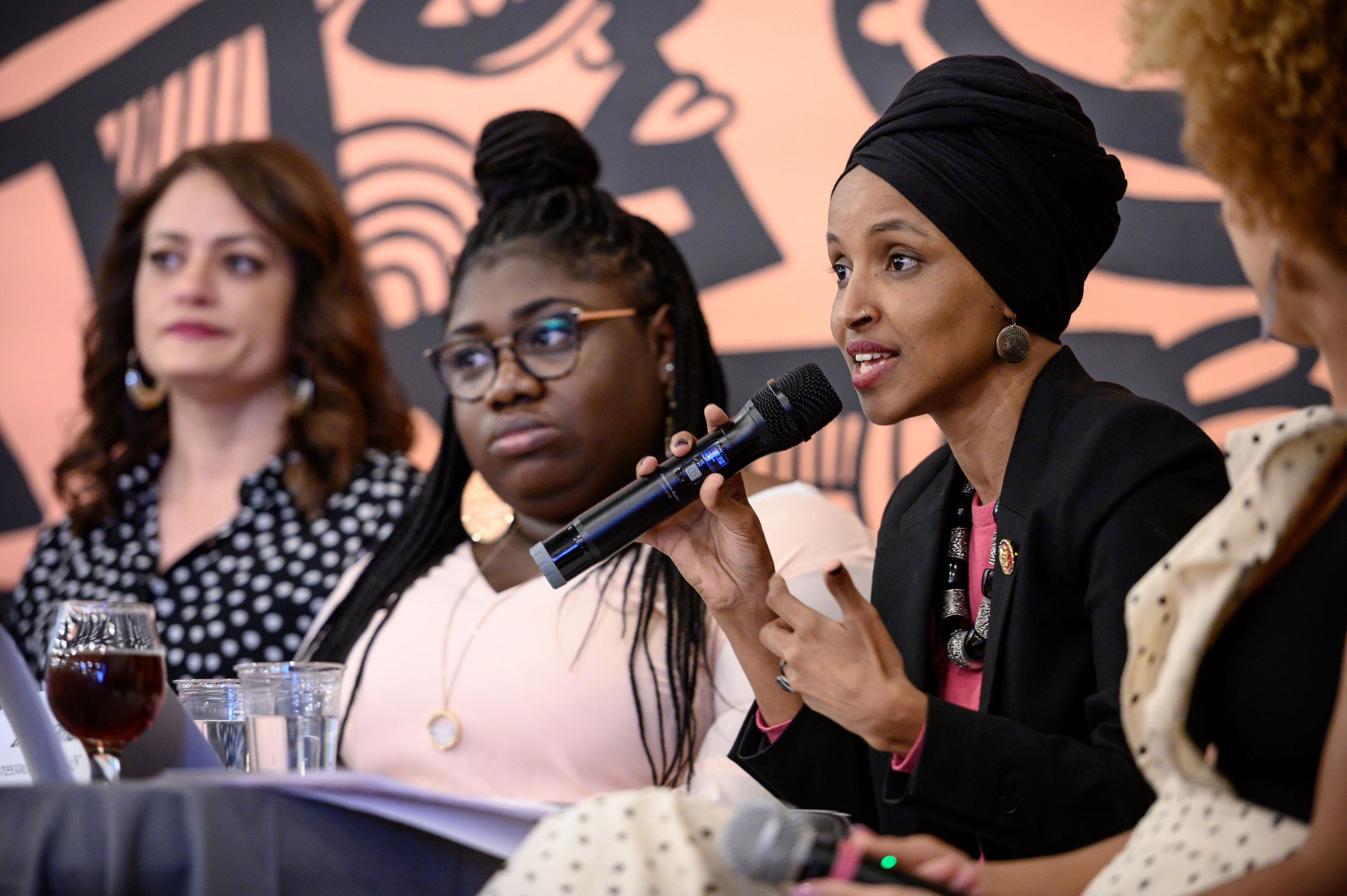 Omar speaks on a panel during the Paycheck Fairness and Women's Workforce Development Town Hall in Minneapolis on April 24, 2