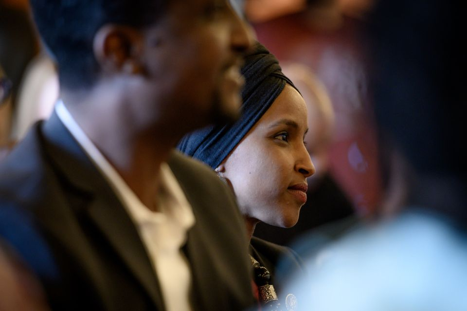 Omar listens to a speaker during the Paycheck Fairness and Women's Workforce Development Town Hall in