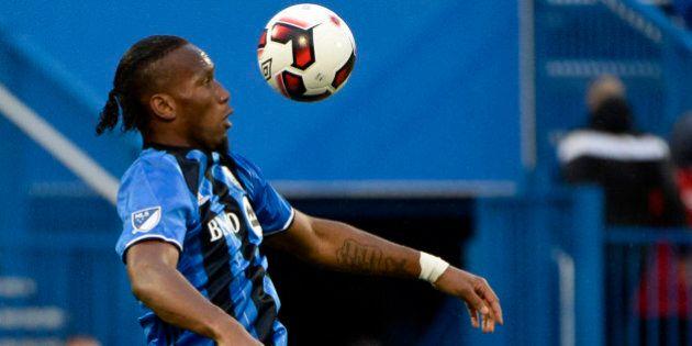 Jun 8, 2016; Montreal, Ontario, Canada; Montreal Impact forward Didier Drogba (11) plays the ball during...