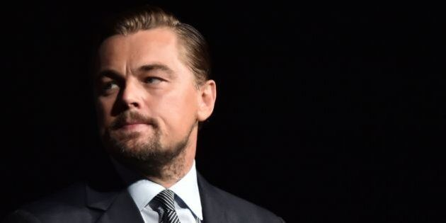 US actor Leonardo DiCaprio looks on prior to speaking on stage during the Paris premiere of the documentary...