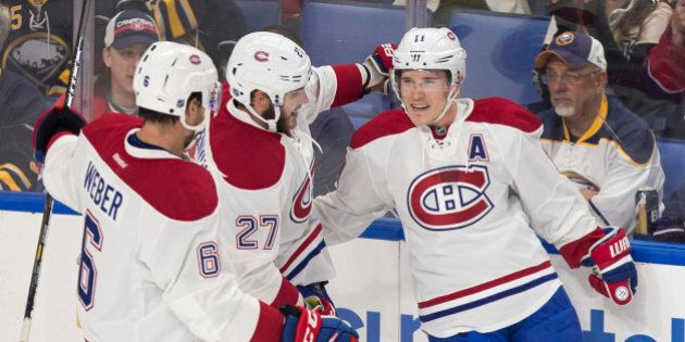 Montreal's Brendan Gallagher (R) celebrates his first period goal with teammates Shea Weber (L) and Alex...