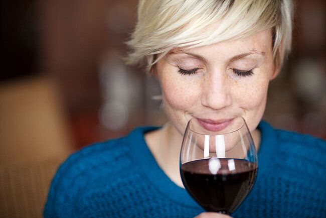 21258879 - closeup portrait of young female customer drinking red wine with eyes closed
