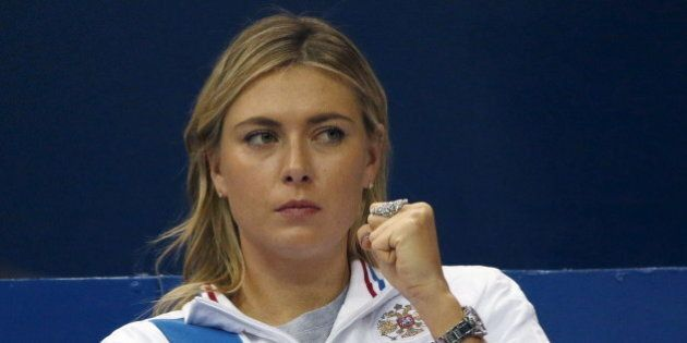 Russia's Maria Sharapova reacts as she watches compatriot Ekaterina Makarova play against Kiki Bertens...