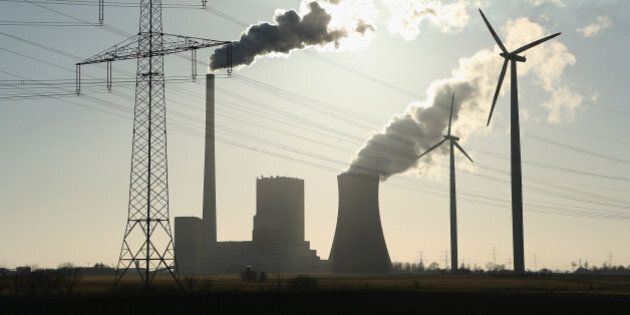 HOHENHAMELN, GERMANY - MARCH 04: Wind turbines and electricity pylons flank the Mehrum coal-fired power...