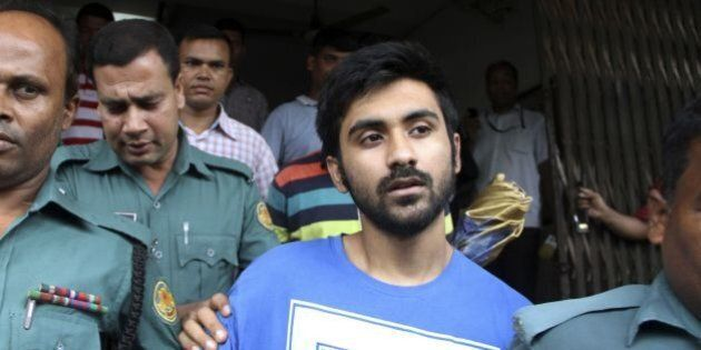 University of Toronto student Tahmid Hasib Khan (C) leaves after his court appearance in the Bangladesh...
