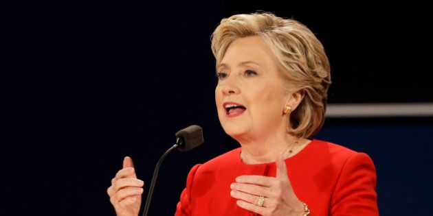 In this Sept. 26, 2016, photo, Democratic presidential candidate Hillary Clinton answers a question during...