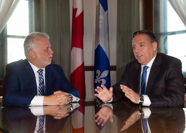Quebec Premier-designate Francois Legault, right and former Quebec Premier Philippe Couillard meet Friday,...
