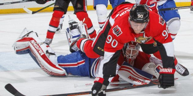 OTTAWA, ON - MARCH 19: Alex Chiasson #90 of the Ottawa Senators bowls over Ben Scrivens #40 of the Montreal...