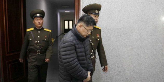 Hyeon Soo Lim, center, who pastors the Light Korean Presbyterian Church in Toronto, is escorted to his...