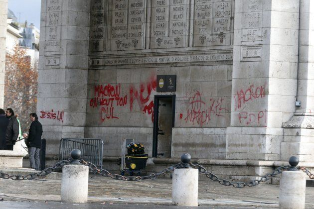 The pillars of the Arc de Triomphe monument tagged in Paris on December 2, 2018, a day after clashes...