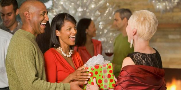 African American couple giving gift at