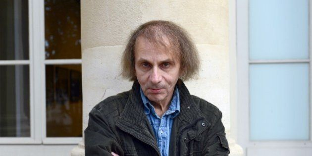 French writer Michel Houellebecq poses on November 5, 2014 during his photo exhibition 'Before Landing'...