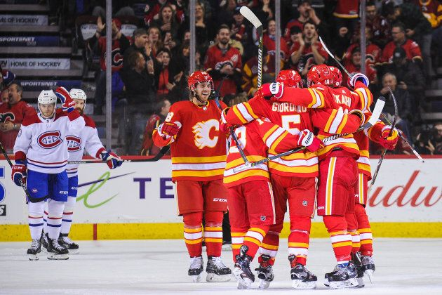 CALGARY, AB - NOVEMBER 15: Matthew Tkachuk #19 (R) of the Calgary Flames celebrates after scoring against...