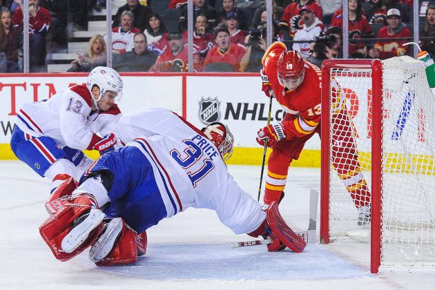 CALGARY, AB - NOVEMBER 15: Johnny Gaudreau #13 of the Calgary Flames takes a shot on the net of Carey...