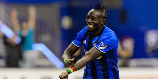 MONTREAL, QC - MARCH 12: Dominic Oduro #7 of the Montreal Impact reacts after scoring early in the second...