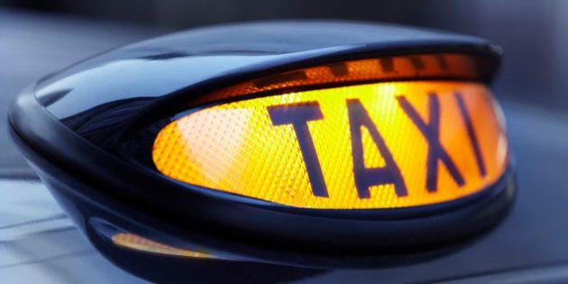 Close up of lit taxi