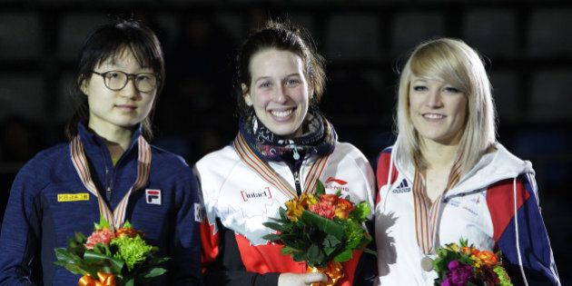 SEOUL, SOUTH KOREA - MARCH 12:  (L to R) Silver medalist Choi Min-Jeong of South Korea, gold medalst Marianne St-Gelais of Canada and bronze medalist Elise Christie of Great Britain celebrate on the podium during the victory ceremony for the Ladies 1500m Finals during the ISU World Short Track Speed Skating Championships 2016 at Mokdong Icerink on March 12, 2016 in Seoul, South Korea.  (Photo by Chung Sung-Jun - ISU/ISU via Getty Images)