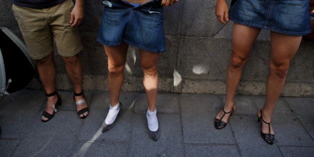 MADRID, SPAIN - JULY 03: Men wear high-heel shoes before the start of the annual high-heel race during...